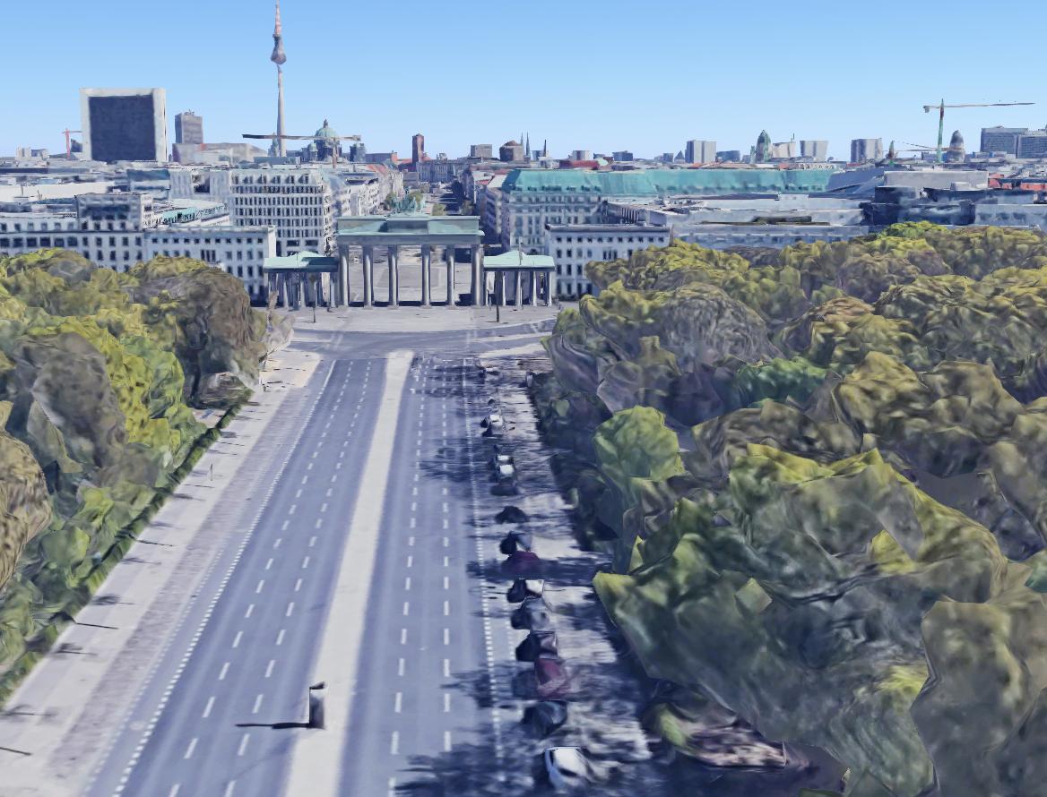 Vergleich damals und heute: Brandenburger Tor in Berlin 1945 - Luftaufnahme im Tiefflug über die Ost-West-Achse und den Pariser Platz